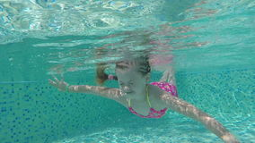 Girl swimming underwater. stock video footage
