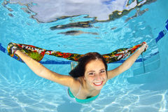 Girl Swimming Underwater with a Scarf Stock Images