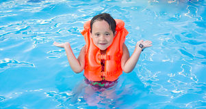 A girl swimming in the water Royalty Free Stock Photo