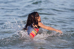 Girl swimming in the water Stock Images
