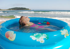 The girl swims. In pool on the sea Royalty Free Stock Photo
