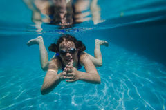 Girl Swims Goggles Underwater Stock Image