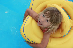 Girl swims in a pool with a circle Royalty Free Stock Photo