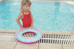 Girl swims in a pool with a circle Stock Photo