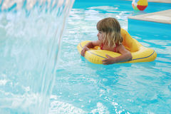 Girl swims in a pool with a circle Royalty Free Stock Image