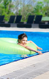 Girl swims in pool in circle Stock Images