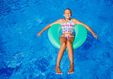 Girl swims in a pool Stock Images