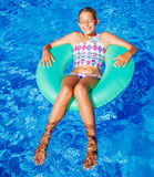 Girl swims in a pool Stock Photography
