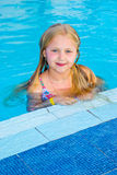 Girl swims in the pool. On a hot sunny day stock image