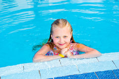 Girl swims in the pool. On a hot sunny day royalty free stock images