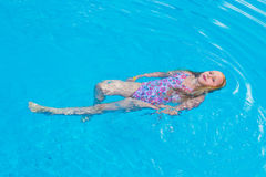 Girl swims in the pool Royalty Free Stock Photography
