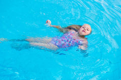 Girl swims in the pool Stock Photography
