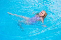 Girl swims in the pool Stock Images