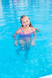 Girl swims in the pool Stock Photo
