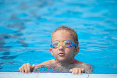 Girl swims in the pool Royalty Free Stock Images