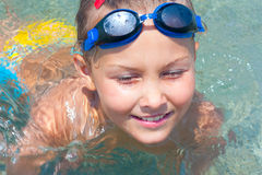 Girl swims in the sea. Royalty Free Stock Images