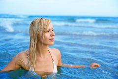 Girl swims in sea Royalty Free Stock Photos