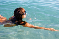 Girl swims in the sea Stock Image