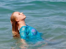 Girl swims in the sea Stock Photos