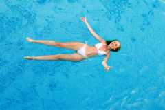 The girl swims in water Royalty Free Stock Photography