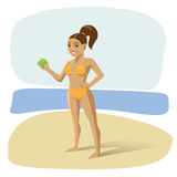 Girl in a swimsuit at the beach with an apple Royalty Free Stock Photos