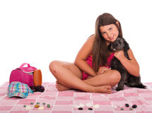 Girl in swimsuit at the beach with dog. Smiling brunette teenage girl in swimsuit at the beach with her shipoo dog (studio setting with beach and personal items Stock Photos