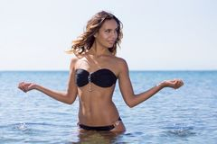 Girl in a swimsuit on the beach. Stock Images