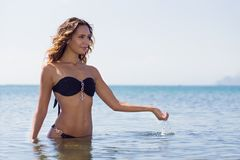Girl in a swimsuit on the beach. Royalty Free Stock Photos