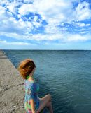 Girl in a swimsuit and Cape, on the beach against the beautiful sky stock illustration