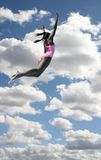 Girl in Swimsuit Diving In Sky Stock Image