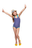 Girl in swimsuit gesturing thumb up. Full length child girl in swimsuit and summer hat giving double thumb up, over white background Royalty Free Stock Images