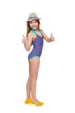 Girl in swimsuit gesturing thumb up. Full length child girl in swimsuit and summer hat giving double thumb up, over white background Stock Photos