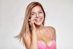 Girl in swimsuit gets on the nose cream and smiles Stock Photos