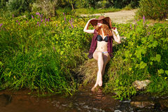Girl in swimsuit and hat. River. Royalty Free Stock Image