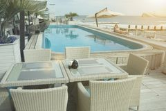 Girl sunbathing by the pool near the sea royalty free stock photos