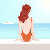 Girl in swimsuit looking at the sea Stock Photos