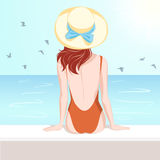 Girl in swimsuit looking at the sea Royalty Free Stock Photo