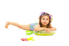 Girl in swimsuit lying on swimming seat Royalty Free Stock Photo
