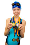 Girl in swimsuit with medals. Isolated on white background royalty free stock photos