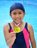Girl in swimsuit with medals Royalty Free Stock Image