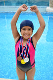 Girl in swimsuit with medals Royalty Free Stock Photo