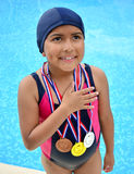 Girl in swimsuit with medals Royalty Free Stock Photos
