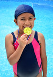 Girl in swimsuit with medals Stock Photo