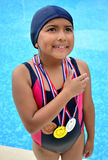 Girl in swimsuit with medals Royalty Free Stock Photography