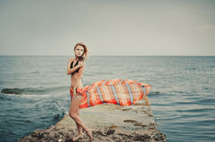 A girl in a swimsuit on a pier stock image