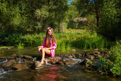 The girl in swimsuit. River. Royalty Free Stock Photo