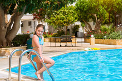 Girl in swimsuit standing at pool, hotel Atali Village, Bali Royalty Free Stock Photography