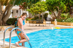 Girl in swimsuit standing at pool, hotel Atali Village, Bali Stock Photography