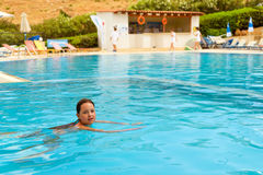 Girl in swimsuit swimming in pool, Bali, Crete Stock Photography