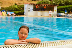 Girl in swimsuit swimming in pool, Bali, Crete Royalty Free Stock Image